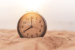 Selective focus of alarm clock with nature background royalty free stock photos