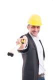 Selective focus of architect smiling holding ruler tape. Isolated on white background Stock Image