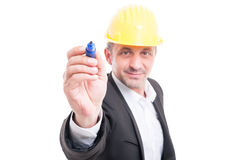 Selective focus of architect wearing hardhat writing with marker Royalty Free Stock Photography