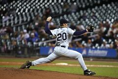 Selective Focus of Baseball Pitcher in 20 Jersey About to Throw Ball Stock Photos