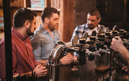 Selective focus of beer taps in the bar Royalty Free Stock Image