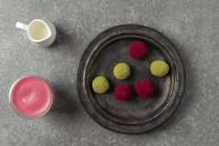 Selective focus on beetroot latte healthy coffee alternative, matcha green tea and pink raspberry beetroot truffles royalty free stock photo