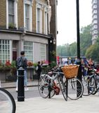 Selective focus of Bicycle with wicker basket on the city street stock image