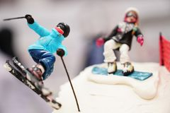 Selective focus of a birthday cake in which skier couples skiing. Downhill in high mountain Stock Images
