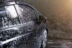 Selective focus of Black Car wash with soap Royalty Free Stock Image