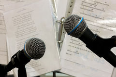 Selective focus bolt microphone on the blur lyric background. Royalty Free Stock Photos