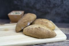 Selective focus of bread and  on wood table for background stock photography