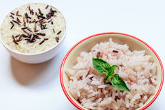Selective focus brown rice,leaf in bowl and rice seed in bowl. Stock Photos