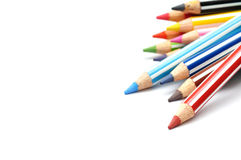 Selective focus of bunch of color pencils with stripe, white background. Stock Image