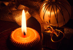 Selective focus candle light and christmas decoration on wood at. The dark light Royalty Free Stock Image