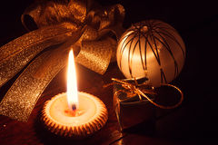 Selective focus candle light and christmas decoration on wood at. The dark light Royalty Free Stock Images