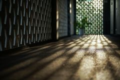 Selective focus on cement floor of corridor reflects the light of sunset with blurred bokeh lights background.  royalty free stock images