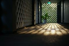 Selective focus on cement floor of corridor reflects the light of sunset with blurred bokeh lights background.  stock images
