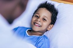 African american boy lying in bed Royalty Free Stock Photo