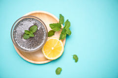 Selective focus of chia seeds drink with water in transparent gl. Ass with lemon balm Royalty Free Stock Images