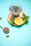 Selective focus of chia seeds drink with water in transparent gl. Ass with lemon balm Royalty Free Stock Image