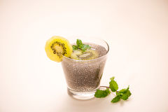 Selective focus of chia seeds drink with water in transparent gl. Ass with lemon balm Royalty Free Stock Photos