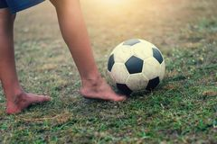 Selective focus children feet play and soccer ball Stock Photography