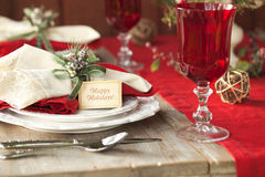Selective focus Christmas dining scene on rustic table Royalty Free Stock Photo