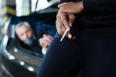 Selective focus of a cigarette being smoked Stock Photos