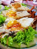 Selective focus, Close up of barbecued shrimp on tray in restaurant. Grilled giant river prawn as a background Macrobrachium rosenbergii, Vertical royalty free stock image