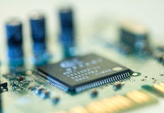 Selective focus of close up computer electronic circuit board Royalty Free Stock Images