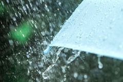 Selective focus for close up a part of umbrella which has Rain d Stock Photography