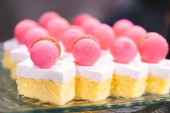 Selective focus close up sliced of pink macaroon butter cake on glass plate royalty free stock photo