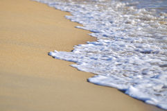 Selective focus of close up waves at the beach Royalty Free Stock Photo