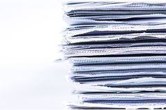 Selective focus of closeup stack of white newspaper paper Royalty Free Stock Photos