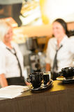 Selective focus of coffee mugs in cafe. Waitresses women cups stock photos