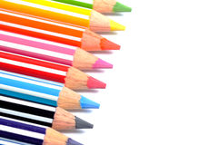 Selective focus of Color pencils with stripes, white background with copy space Royalty Free Stock Photos