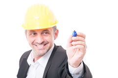 Selective focus of contractor wearing hardhat writing with marke Royalty Free Stock Image
