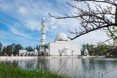 Beautiful nature and reflection of Tengku Tengah Zaharah Mosque, Terengganu Malaysia. Selective focus and cropped image of The beautiful nature and reflection of Stock Photos