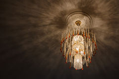 Selective focus of Crystal Chandelier , ceiling lights, black shadows Royalty Free Stock Photos