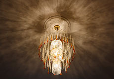 Selective focus of Crystal Chandelier , ceiling lights, black shadows Stock Images