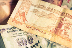 Selective focus on currencies of UAE anf India Royalty Free Stock Photos