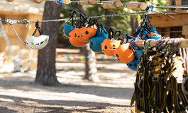 Selective focus of different helmets hanging on the rope. Safety equipment. Special safety helmets hanging upside down on the rope in the adventure park Stock Images