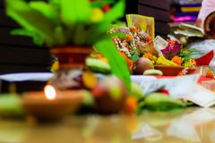 Selective focus. Diwali puja or Laxmi puja set up at home. Oil lamp or diya with crackers, sweet, dry fruits, indian currency,. Flowers and statue of Goddess royalty free stock image