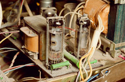 Selective focus on dusty vintage tube inside retro radio station. Royalty Free Stock Images