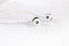 Selective focus of earphones on white background Royalty Free Stock Image