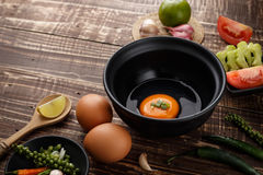 Selective focus egg in bowl and ingredients on wood background. Side view Stock Image