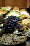 Exhibitor of raisins and dried fruits. Selective focus of exhibitor of healthy raisins and dried fruits Royalty Free Stock Image