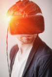 Selective focus on face. Handsome man wearing virtual reality glasses   a gray background Stock Image