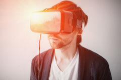 Selective focus on face. Handsome man wearing virtual reality glasses isolated a gray background Stock Photography