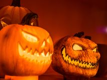 The selective focus on the face of an orange scary pumpkin with Royalty Free Stock Images