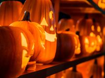 The selective focus on the face of an orange scary pumpkin with Royalty Free Stock Photography