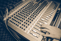 Selective focus finger sound tuning of sound mixer Stock Images