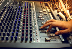 Selective focus finger sound tuning of sound mixer Stock Photo