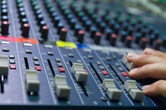 Selective focus finger tuning of sound mixer close up Stock Photos